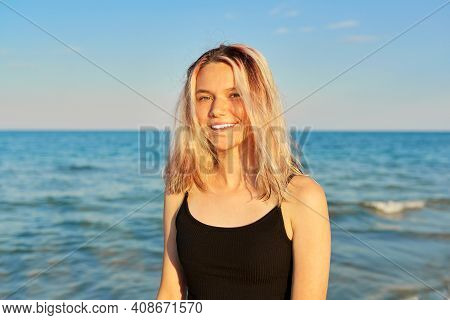Outdoor Portrait Of 16 Year Old Female Teenager. Beautiful Happy Smiling Looking At Camera Woman Wit