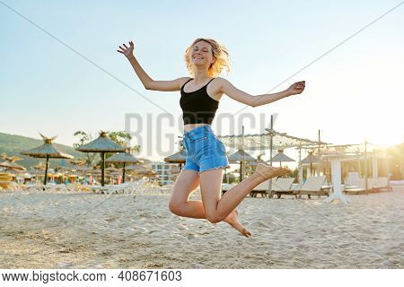 Happiness, Joy, Freedom, Youth, Vacation, Summertime Concept. Beautiful Happy Female Teenager On The