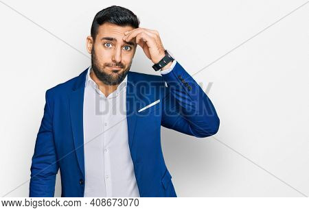 Young hispanic man wearing business jacket worried and stressed about a problem with hand on forehead, nervous and anxious for crisis