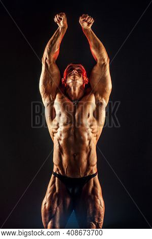 Shirtless Man With Muscular Topless Body Holding Arms Up. Isolated.