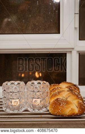 Jewish Sabbath With Challah Handmade Tasty Bread And Candle.