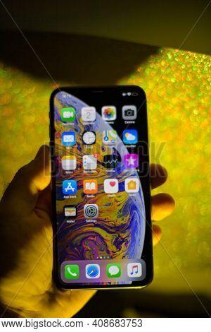 Paris, France - Oct 2, 2018: Defocused Pov Male Hand Holding New Apple Computers Iphone Xs 11 12 13