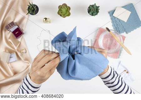 Woman Hands Cleaning And Polishing Jewelry Ring With Homemade Jewelry Cleaner At Home. Top View