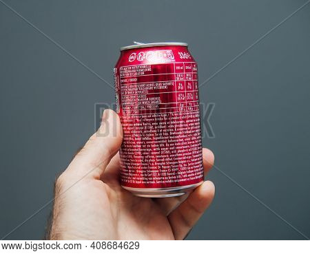 Paris, France - May 3, 2020: Pov Male Hand Holding Top Of Aluminum Can Of Dr Pepper Manufactured By