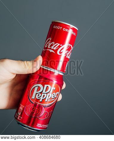 Paris, France - May 3, 2020: Pov Male Hand Holding Aluminum Can Of Coca Cola And Dr Pepper Manufactu