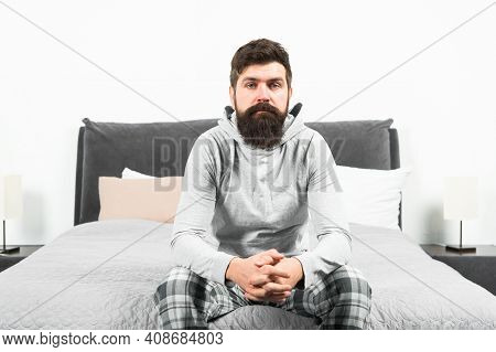 Tips For Waking Up Early. Man Bearded Hipster Sleepy Face Pajamas Waking Up Bedroom Interior. Daily