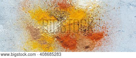 Variety Of Spices On A Blue Background. Powdered Spices, Dried Garlic, Dried Onions, Smoked Paprika,