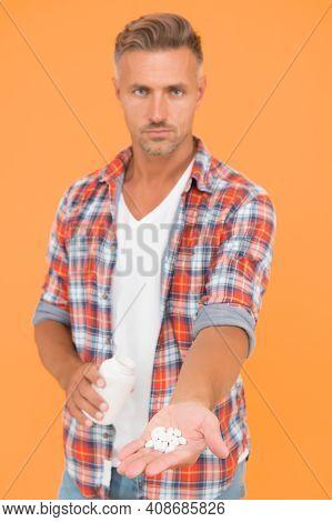 Food Additives Vitamins Male Health. Vitamin Complex. Handsome Man Presenting Product Selective Focu