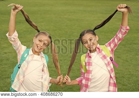 For Style And Care You Deserve. Happy Children Hold Long Hair Tails. Hair Care. Haircare. Children C