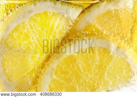 Slices Of Lemon In Fizzy Mineral Water