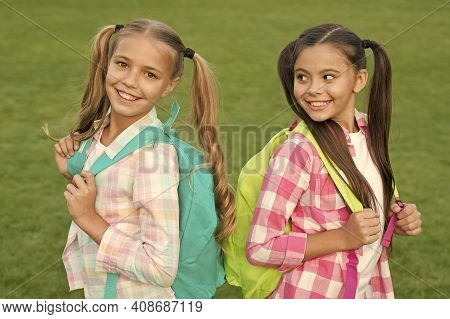 Back To School. Cute Schoolgirls With Long Ponytails. Ending Of School Year. Cheerful Smart Schoolgi