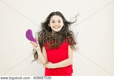 Girl Adorable Kid Long Wavy Hair Yellow Background. Wind Can Also Damage Hair. Things You Doing To D