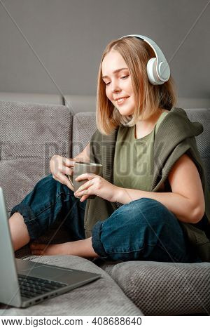 Teenager Girl In Sportswear Make Remote Yoga Class Seated In Lotus Position During Stay Home. Young