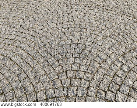 Granite Paving Stones On The Sidewalk, Textured Paving Background.