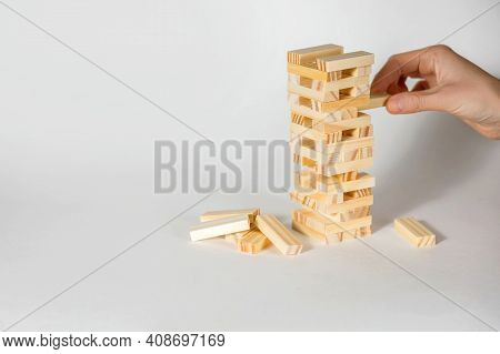 Board Game Wooden On A White Background. People Play A Game Of Chance In Which Balance And Composure