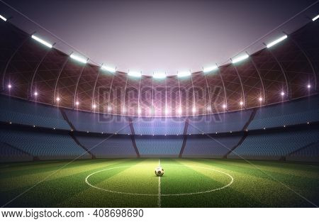 Soccer Field In The Sports Stadium. Soccer Ball Illuminated In The Center By The Surrounding Lights.