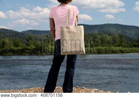 Woman In Pink Tee Holding Tote Bag Mockup