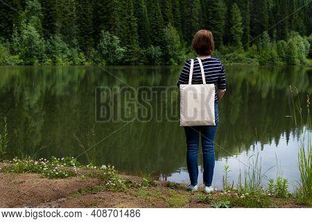 Woman Carrying Tote Bag On The Lake Shore, Mockup