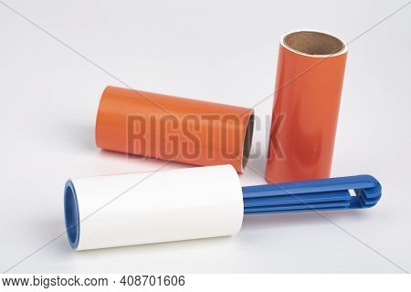 Lint Roller With Blue Handle On Bright Background
