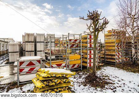 Stack Of Barrier Planks In Industrial Metal Shelves