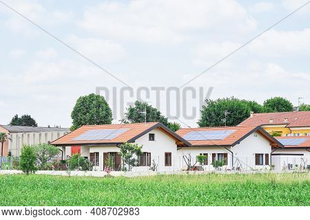 Renewable Energy System On Roof Of Traditional Houses In Contemporary Suburban Neighborhood In Italy
