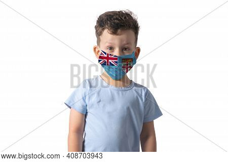 Respirator With Flag Of Fiji. White Boy Puts On Medical Face Mask Isolated On White Background.