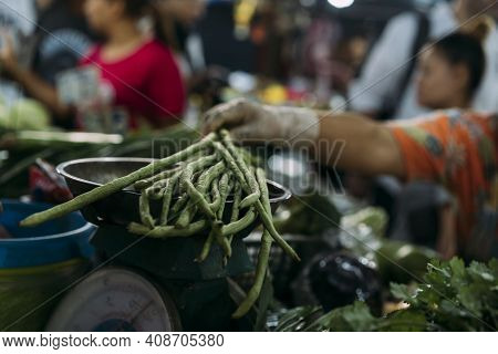 Green Beans Being Weight On A Scale At A Fresh Market In Bangkok, Thailand.
