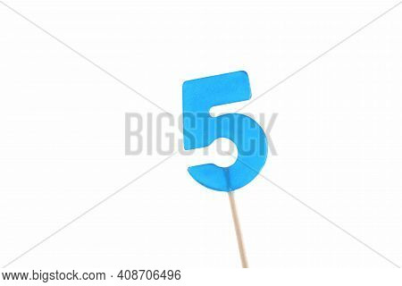 Lolipop In Number 5 Shape. Sweet Candy On Wooden Stick. Blue Number 5 Isolated On A White Background