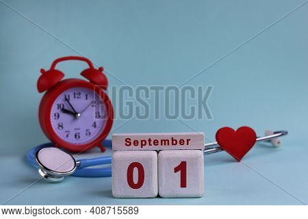 September 1. 1st Day Of The Month. White Wooden Calendar Blocks With Date, Clock And Stethoscope On