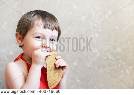 Little Happy Boy Eating Pancakes With His Hands. Delicious Pancakes.
