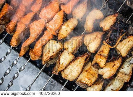 Fish Kebab On Skewers On The Grill In Winter. Salmon And Halibut