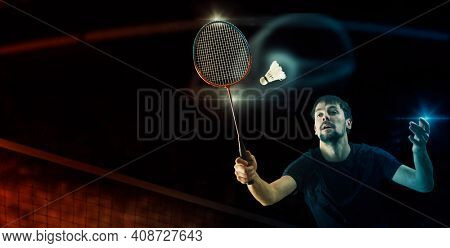 Man badminton player in action during game