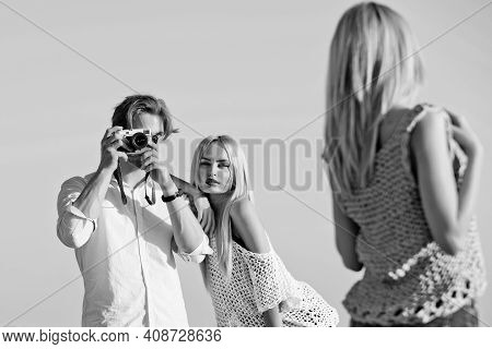 Fashion Friends On Photoshoot. Handsome Man Photographer With Camera Shooting Sexy Girls Or Pretty W