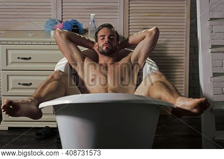 Man Gay With Muscular Body In Bath. Bathing, Shower, Spa. Hygiene, Grooming, Health. Sexy Guy Relax