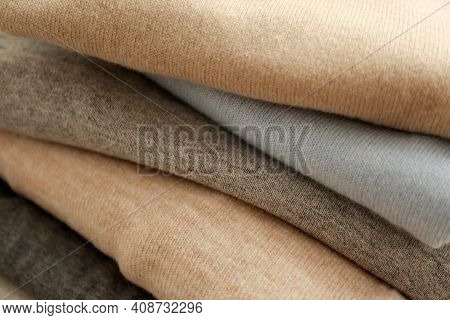 Stack Of Cashmere Clothes As Background, Closeup