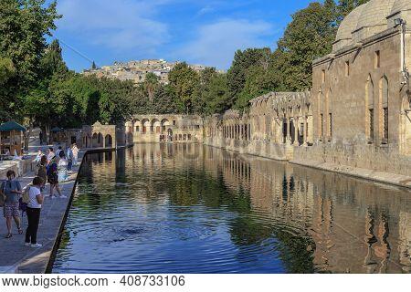 Sanliurfa, Turkey - October 8, 2020: This Is The Sacred Balikly-gol Lake With Sacred Carps, Turned B