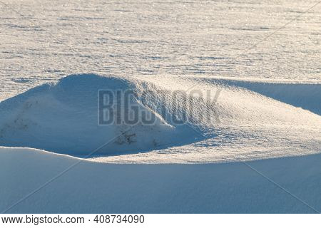 Snow Banks On A Sunny To Cold Winter Day In The Field