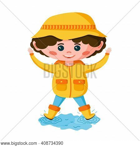 A Cute Boy In A Yellow Jacket And Rubber Boots Jumps Through Puddles. The Kid Has Fun With His Hands