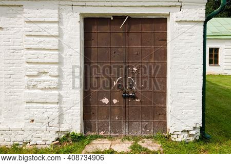 Old Iron Doors Latching Shut On A Summer Day