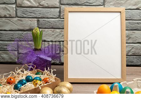 Happy Easter Concept With Easter Eggs And Copy Space. Wood Frame With Space For Text