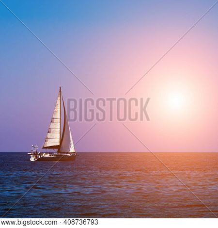 Sailboat at sea during sunset