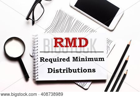 On A White Background Glasses, A Magnifier, Pencils, A Smartphone And A Notebook With The Text Rmd R