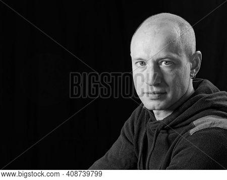 Bw Portrait Of A Bald Man On A Black Background