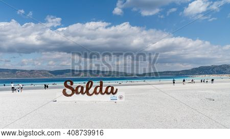 Salda Lake, Burdur, Turkey - October 2019: Salda Lake Signage At The Beach Of Salda Lake With Touris