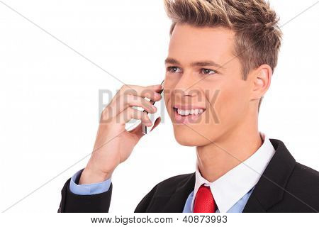 Close-up of a happy man calling with his smartphone against white background