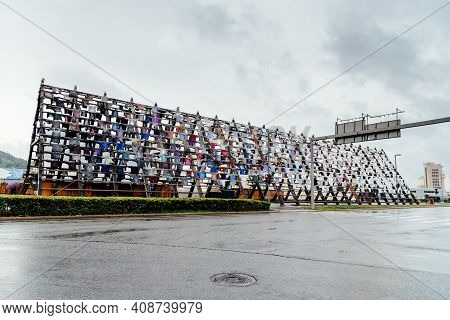 Oslo, Norway - August 10, 2019: Typical Fish Dryer Made Of Wood Covered With Hundreds Of Old Shirts