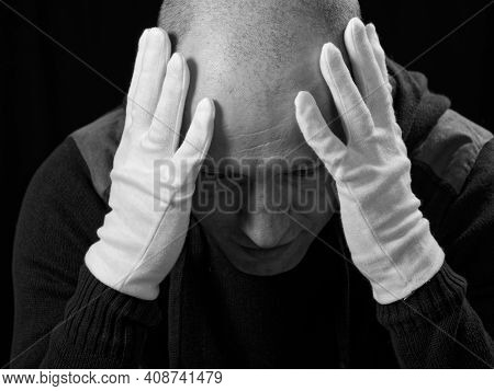 Bw Portrait Of A Bald Man In White Gloves On A Black Background