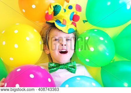 Funny Laughing Child Clown With Multicolored Balloons. Birthday Party Concept. April Fools Day Celeb