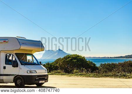 Male Tourist Travelling With Caravan. Gibraltar Rock On Horizon, Andalucia, Spain. Roadtrip, Vacatio