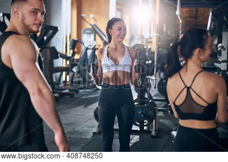 Cheerful Friends Spending Active Time In Gym